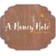 A Honey Hole Estate Sales Logo