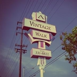 A Vintage Walk Estate Sale Services Logo